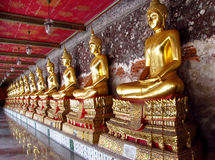 Many Gold-colored Buddha statue in Buddhist temple Stock Images