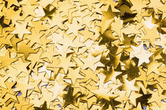 Many gold star decorations background Stock Images