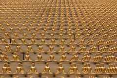 Many golden Buddha figurine in Bangkok, Thailand Royalty Free Stock Photos