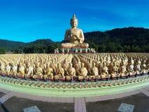 Many golden buddha statues at Buddha Makabucha Memorial park. Stock Photos