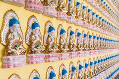 Many golden buddha statues Stock Photography