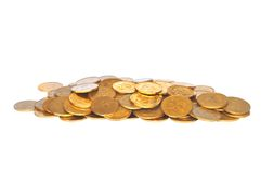 Many golden coins  on white Royalty Free Stock Photos