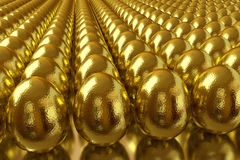 Many golden eggs. Rows golden eggs on the shiny table Stock Photography