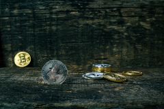 Many golden and silver bitcoins on a wooden surface, background with vintage effect, cryptocurrency concept for business idea, clo. Many golden and silver royalty free stock image