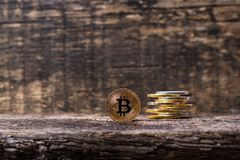 Many golden and silver bitcoins on a wooden surface, background with vintage effect, cryptocurrency concept for business idea, clo. Many golden and silver stock photo