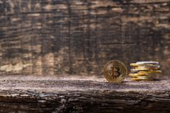 Many golden and silver bitcoins on a wooden surface, background with vintage effect, cryptocurrency concept for business idea, clo. Many golden and silver stock images