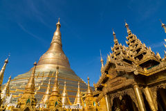 Many golden spires at the Shwedagon pagoda Stock Photo