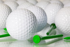 Many golf balls on a glass table Stock Image