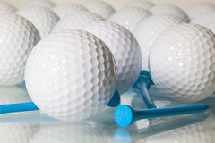 Many golf balls on a glass table Royalty Free Stock Image