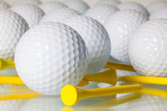 Many golf balls on a glass table Stock Photography