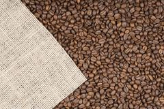 Grains of coffee on which left burlap with copy space Royalty Free Stock Images