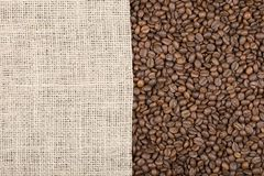 Grains of coffee on which left burlap with copy space Royalty Free Stock Image