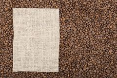 Grains of coffee on which left burlap with copy space Royalty Free Stock Photo
