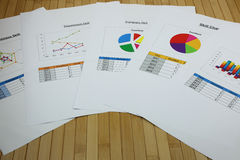 Many graphs in the paper on the bamboo desk Stock Images