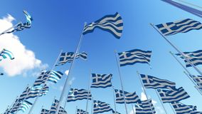 Many Greece flags on flagpoles against blue sky. stock video footage