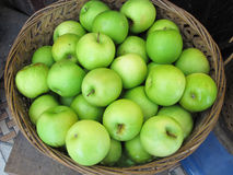 Many green fresh apple fruits with basket Royalty Free Stock Image