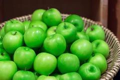 Many green juicy apple fruits in market Stock Photo