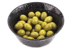 Many green olives in a bowl,  Stock Photo