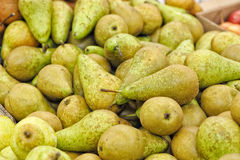 Many green pears at a famers supermarket Royalty Free Stock Photography