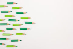 Many green pens forming an arrow to the right with space for copy text Stock Images