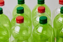 Many green plastic bottles with caps stock photo