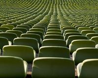 Green seat shells in a football stadium royalty free stock images