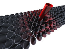 Many grey pipes with one big red Royalty Free Stock Images