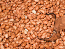 Many groundnut peeled off. Apply a lot of groundnut, brown background stock photos