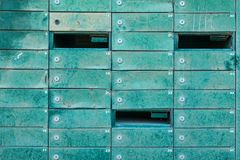 Many old mailboxes. Many grunge mailboxes in a stack, some of them broken into Royalty Free Stock Image