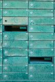 Many old mailboxes. Many grunge mailboxes in a stack, some of them broken into Stock Photos