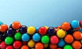 Many gumballs. On blue background Royalty Free Stock Photos