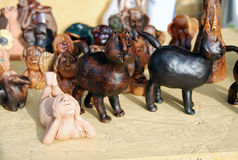 Many hand-made animals souvenirs on the table. Many hand-made animals souvenirs made of clay. There are cats, a mermaid, an elephant, a dog etc. Photo was taken royalty free stock photo