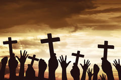 Many hand pray and holding christian cross Royalty Free Stock Images