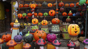 Many handcrafted fluorescent pumpkins made of clay Stock Photos