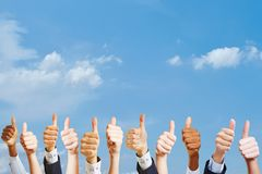 Many hands as motivation at work. Many hands holding thumbs up as motivation at work concept Royalty Free Stock Photography