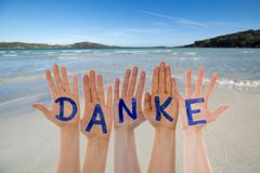 Many Hands Building Danke Means Thank You, Beach And Ocean