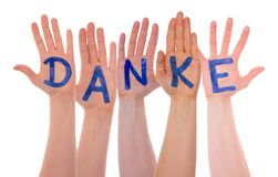 Many Hands Building Danke Means Thank You, Isolated. Many Hands Building German Word Danke Means Thank You. Hands Are On White And Isolated stock photos