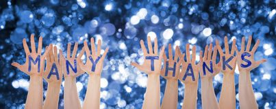 Hands Building Many Thanks, Glittering And Sparkling Bokeh Background. Many Hands Building English Word Many Thanks. Glittering, Sparkling And Magic Bokeh And royalty free stock photos