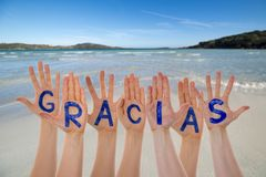 Many Hands Building Gracias Means Thank You, Beach And Ocean
