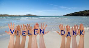 Many Hands Building Vielen Dank Means Thank You, Beach And Ocean. Many Hands Building German Word Vielen Dank Means Thank You. Beautiful Beach, Ocean And Sea As royalty free stock photography