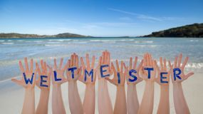Many Hands Building Weltmeister Means World Champion, Beach And Ocean. Many Hands Building German Word Weltmeister Means World Champion. Beautiful Beach, Ocean stock photo