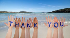 Many Hands Building Word Thank You, Beach And Ocean