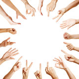 Many hands in circle with different gestures Stock Photos
