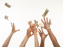 Many hands competing for catching money falling from above, whit Stock Photos