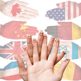 Many hands with different country flags. Painted on them  on white Stock Photography