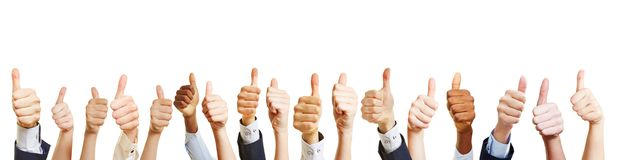 Many hands hold thumbs up royalty free stock image