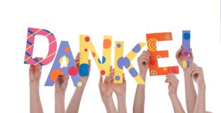 Many Hands Holding a Colorful Danke. Many Hands Holding the Colorful German Word Danke Which Means Thanks, Isolated royalty free stock photos
