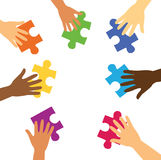 Many hands holding colorful puzzle pieces Royalty Free Stock Image