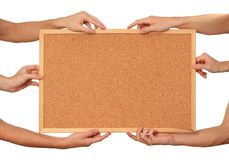 Many hands holding the cork board Stock Photo