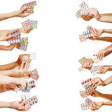 Many hands holding drugs and pills Royalty Free Stock Photo